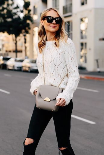 3b9e6a7fec Blonde Woman Wearing Reformation White Pointelle Sweater Madewell Black  Ripped Skinny Jeans Polene Grey Handbag Fashion