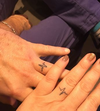 Ring finger tattoo of heartbeats for happily married couple. Designed by Scott and Martha Bowles is Austin, Texas #CoolTattooForCouples
