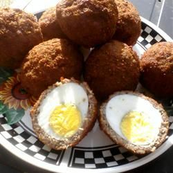 Scotch Eggs recipe - these are DELISH.  I've also tried some variations:  wrapping the eggs in bacon and/or cheese before adding the sausage layer - YUM.  Hint:  tastes best when still warm & dipped in spicy mustard.  Filling enough to be a meal, or great at parties for appetizers.