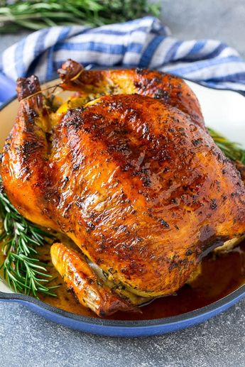 This roasted chicken is coated in a garlic and herb butter, then cooked to golden brown perfection. My roast chicken is tender and juicy and it comes out perfect every time! There's nothing more satisfying