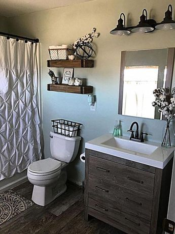 Shelves-Hobby Lobby. Light fixture- Lowes. Vanity and mirror combo- Home Depot. Shower curtain- Target. Wall color- Sea Salt by Sherwin Williams. #farmhousebathroomdesign