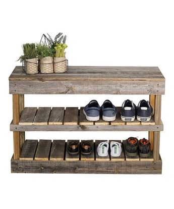 This shoe rack made from reclaim wood doubles as a cozy bench. Use the ample space to display your shoes, and enjoy a place to sit while you're putting them on.