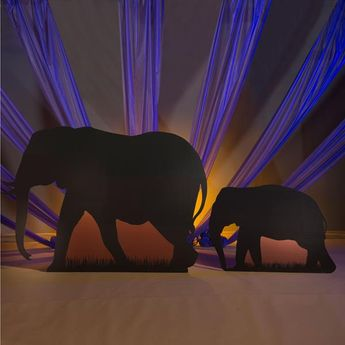 Accent your jungle or safari themed celebration with Wild Safari Dreams Elephant Standees. These free-standing props feature elephant silhouettes printed on one side and make an amazing addition to your decorations.
