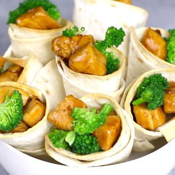 Teriyaki Chicken Cones are so fun to make for a party. Teriyaki chicken is loaded into crispy tortilla cones with broccoli for a mouthwatering appetizer everyone will love.