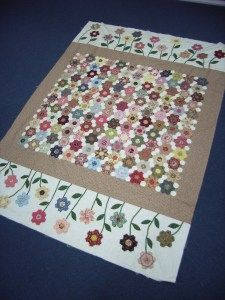 Love the idea of a flower border. Think it would be great on grandmother's garden quilts.