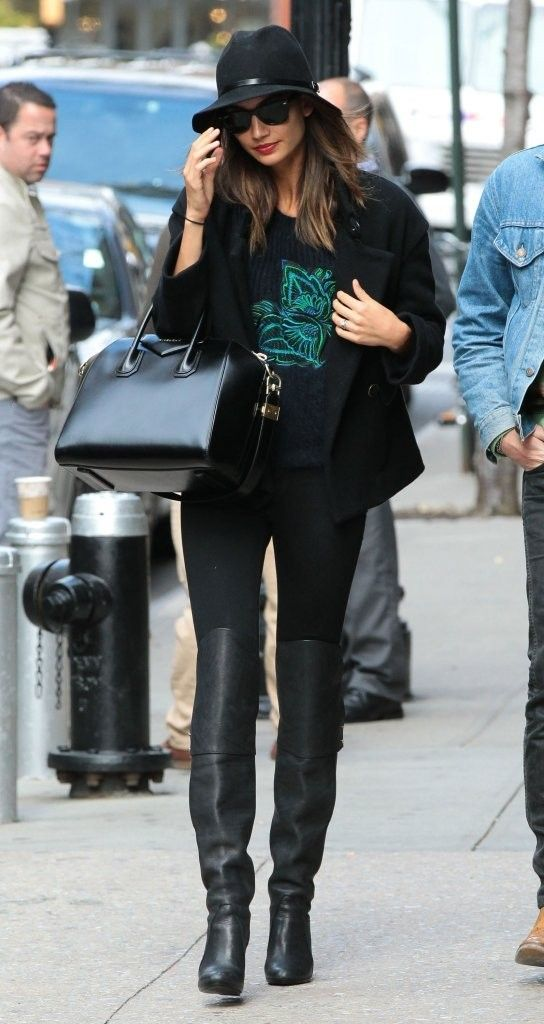 Model Lily Aldridge looks effortlessly chic in this easy-to-replicate look. She wore over-the-knee boots with a tee, a black coat and a wide-brim hat.