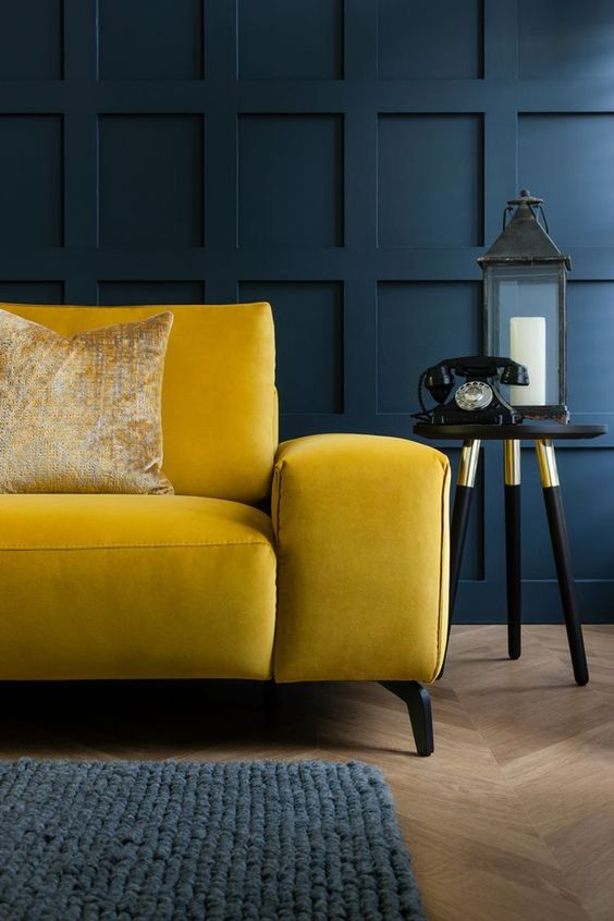 Mustard yellow couch with blue wall