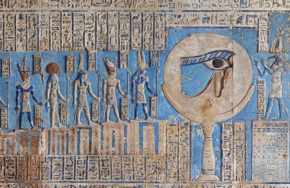 """[EGYPT 29567]<br /> 'The waxing moon and the Eye of Horus at Dendera.'<br /> <br /> This forceful image of the moon on a pillar, decorated with the """"healed eye"""" of Horus, can be found on the astronomical ceiling of the outer hypostyle hall in the Hathor Temple at Dendera.<br /> The astronomical ceiling consists of seven separate strips but here we are looking at a detail of the FIRST STRIP WEST from centre.<br /> The deities in this picture form part of a panel that deals with the waxing moo..."""