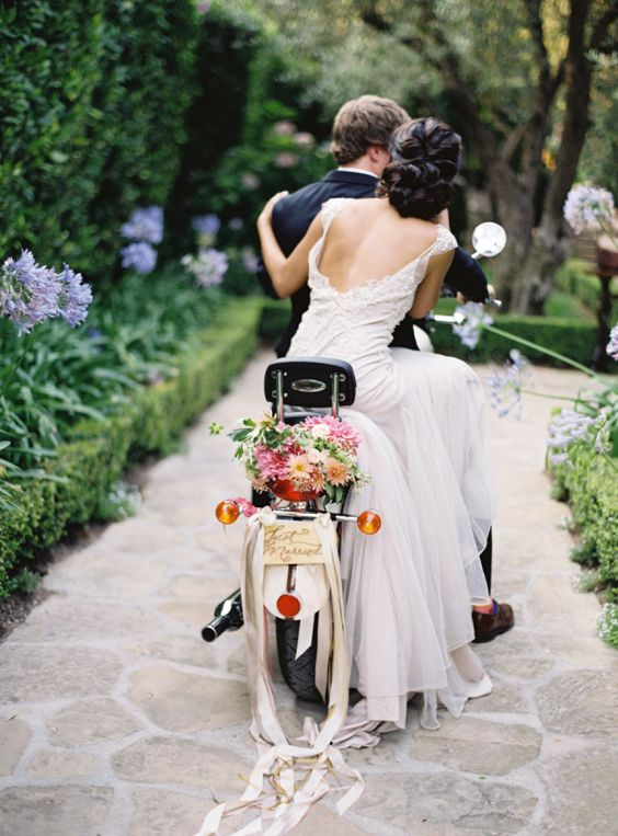 Riding off into the sunset with this adorable motorcycle decorated for the newlyweds.