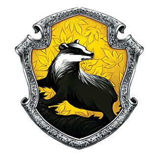 Hufflepuff crest | Hufflepuffs value hard work, patience, loyalty and fair play. The house has produced its share of great wizards--not least Newt Scamander, author of FANTASTICS BEASTS AND WHERE TO FIND THEM.