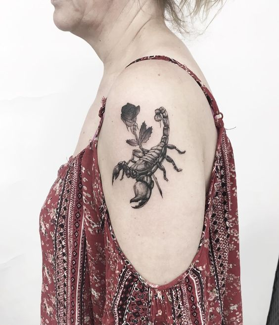 A black realistic scorpion tattoo with rose- 27 Low-key Gorgeous Scorpio Tattoos