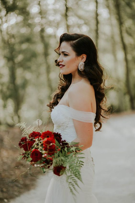 Old Hollywood glam bridal style with an off-the-shoulder gown, voluminous curls, and red lipstick | Image by Dearheart Photos