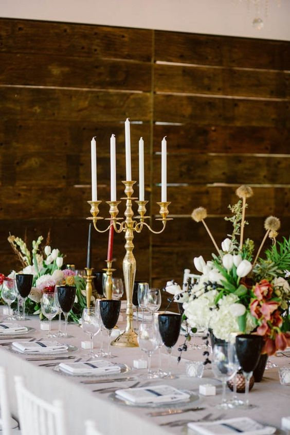 Vibrant flowers, gold candlesticks, and black glasses - love this look | Photo by Lad and Lass