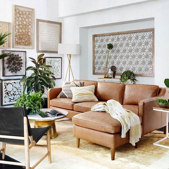 Trang trí phòng khách nhỏ thông minh cùng sofa da thật tphcm