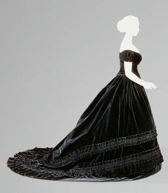 In the style of Charles Frederick Worth, Black Velvet Dress Belonging to Empress Elisabeth, ca. 1860–1865, restored 1998 and 2014. Velvet and silk. Kunsthistorisches Museum, Vienna, Austria.
