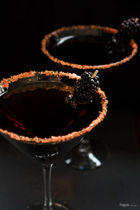 "What gives this sultry ""Black Devil Martini"" its edge? A little vermouth, a little rum, a blackberry garnish and boo-m. Serve it up at this year's Halloween party to give your guests a little spook. Click through for the recipe and more easy Halloween cocktails."