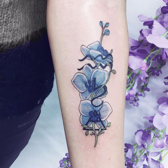 Blue orchids with Aquarius, Saturn and Air symbols intertwined 💙 thanks Nicole