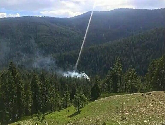 """Evidence of a Direct Energy Weapon (DEW)! Notice the beam of light coming from the sky which in turn is starting a forest fire! DEW's are being manufactured by Lockheed Martin for the US government in effect to burn people off their land completing the Agenda 2030 Biodiversity red zone map!  The recent California and Greece fires were all started using direct energy lasers as shown in this photo!"""