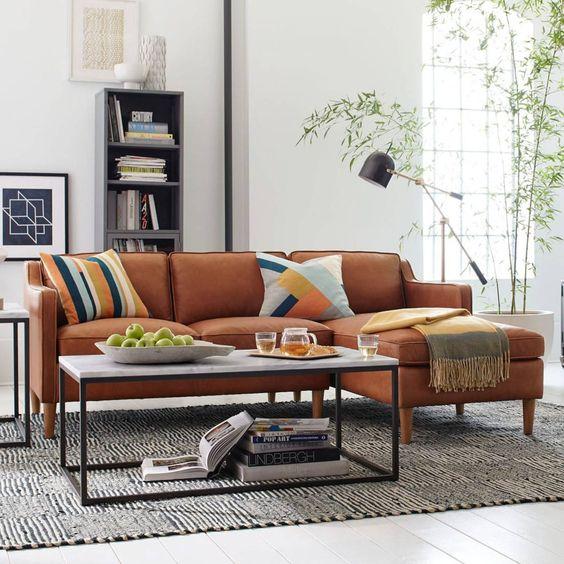 Làm mềm mại phòng khách cùng sofa da tphcm