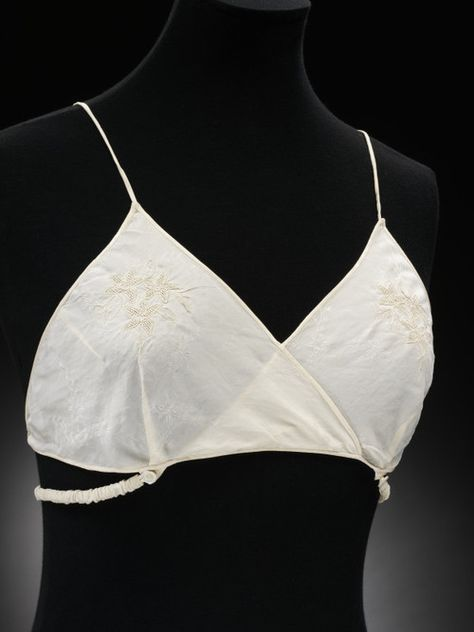 "Brassiere - 1930s - The Victoria & Albert Museum ""As dresses became more body-conscious in the 1930s, underwear changed as well.  Bras now help breasts up to make a more womanly silhouette"""