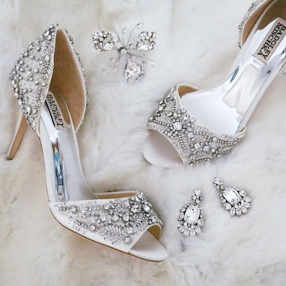 sparkle for serious sparkle girls. Badgley Mischka Wedding Shoes, Erin Cole Hairpin, Cheryl King Couture chandelier earrings. Everything you need after the dress.