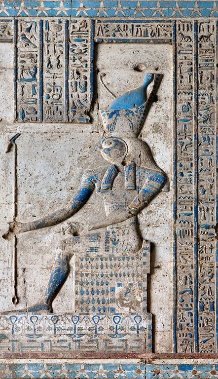 [EGYPT 29600] 'Horus in Dendera.'  A relief in the Hathor Temple at Dendera shows Horus of Edfu, sitting on a throne and wearing the combined crowns of Upper and Lower Egypt. The relief is located on the (interior) eastern wall of the outer hypostyle hall of the temple and dates from the first century AD. Photo Paul Smit.
