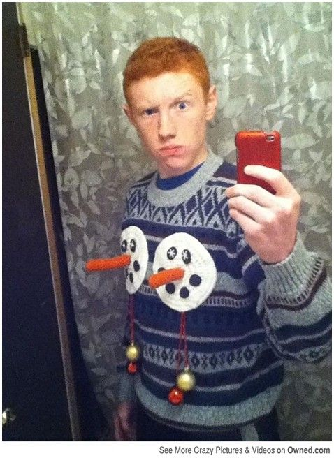 taking selfie wearing his ugly sweater www.teelieturner.com #christmassweaters