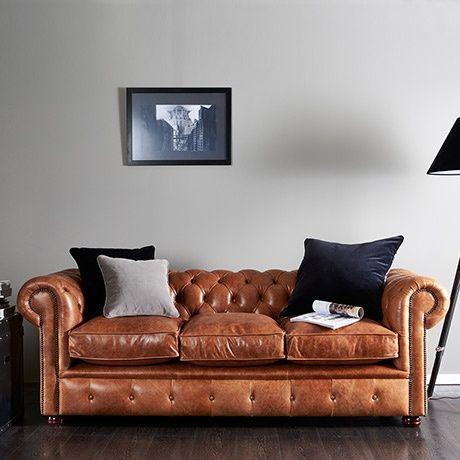Bạn nên chọn mua sofa da tphcm chân gỗ hay chân inox