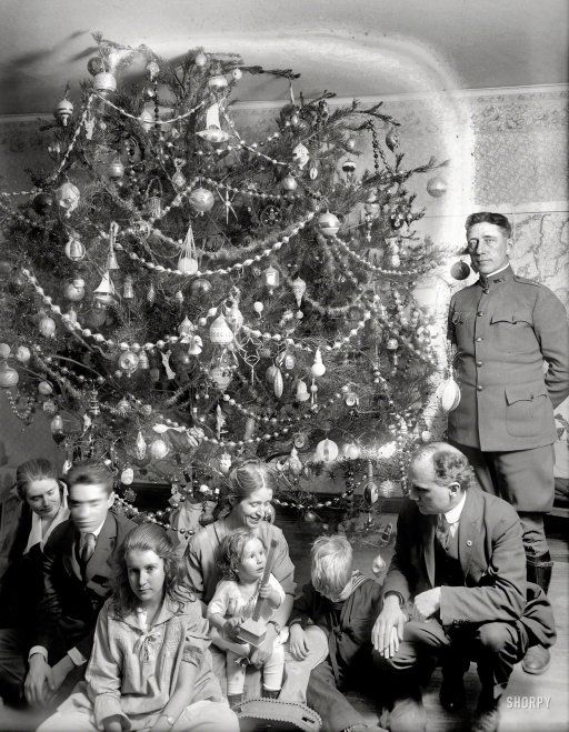 """Like! """"Dickey Christmas tree -- 1918."""" When Christmas trees were still wild and crazy. I love the crazy tree!"""