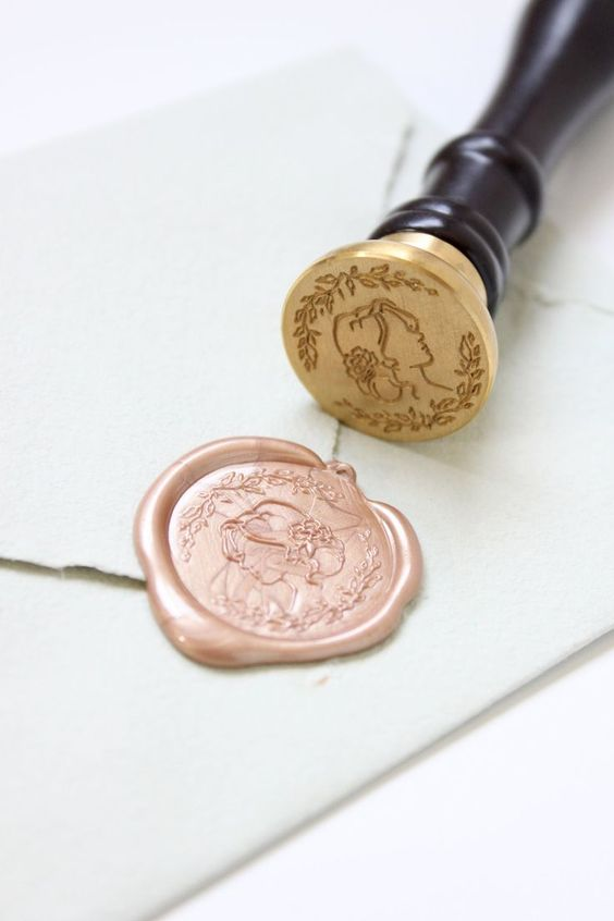 "Stamp wax seals like a pro with these tips from professional fine art stationer, Katrina Crouch! Wax Seal tutorial with rose gold wax featuring the ""Blushed Bride"" seal exclusively at Artisaire.com 