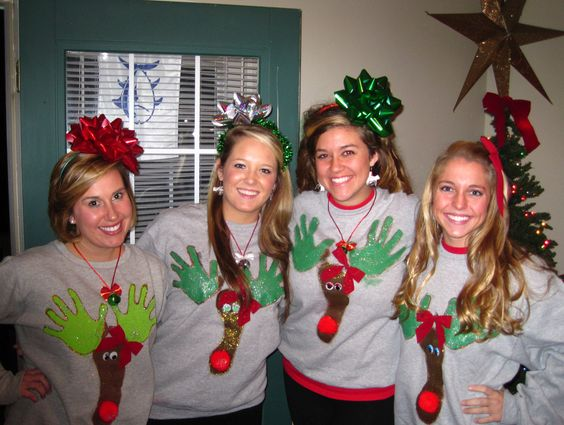 "tacky sweaters and big hair bows....I think it's funny that the ""antler"" handprints are right on their ta-ta's."