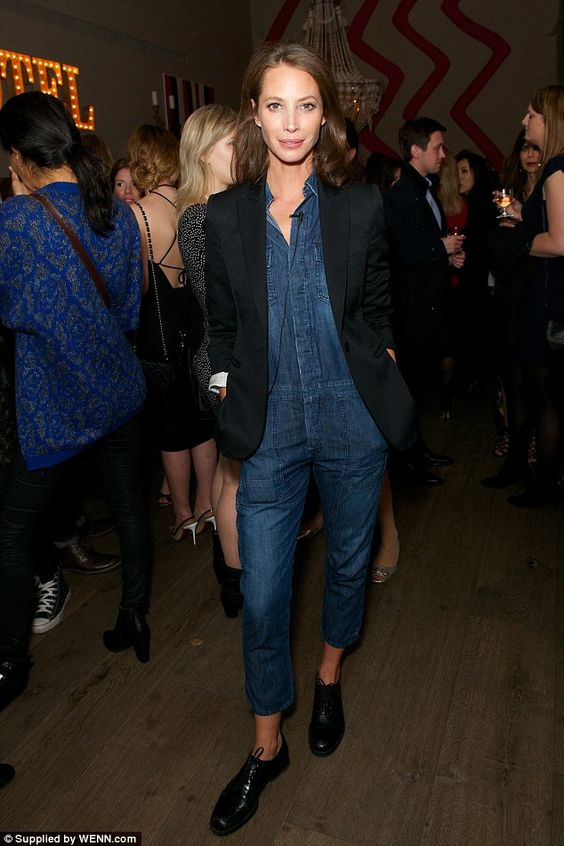 Smart casual: Supermodel Christy Turlington Burns teamed her denim jumpsuit with a plain black blazer and black brogues