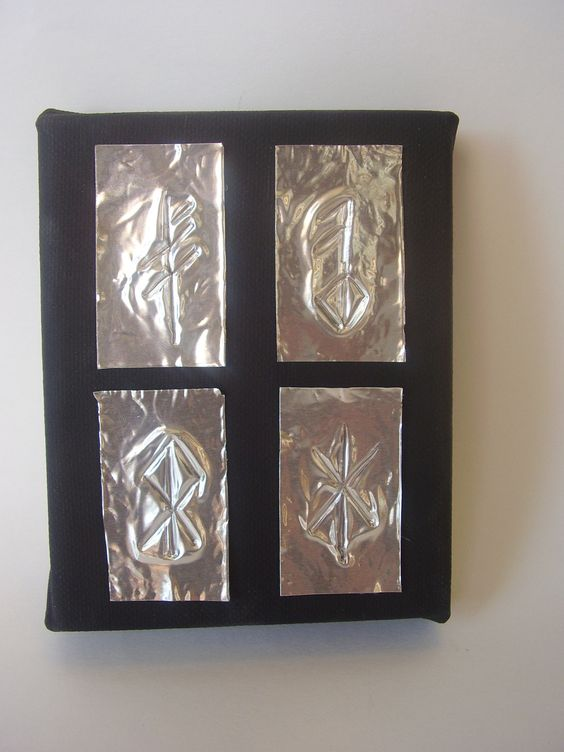 Viking Rune Symbols of luck, love, heart and strength on craft silver foil