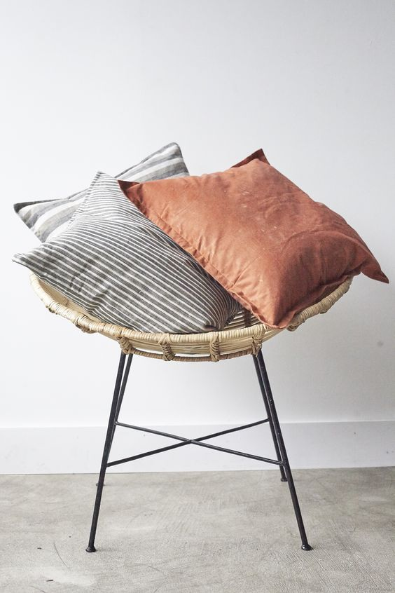 Our range of ethically made organic cushions sitting on the Edwina chair
