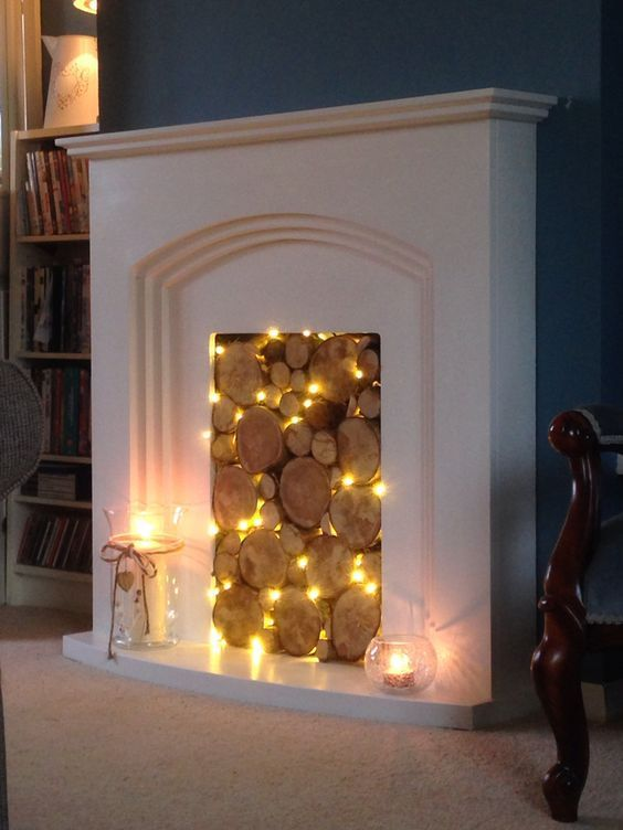 07 A Non Working Fireplace With Wood Slices And String Lights In Between Them For A Natural Look