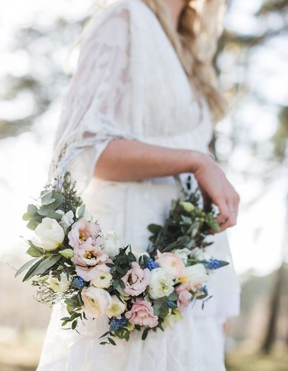 These beautiful floral wreath ideas, like this gorgeous bridesmaid bouquet, will spin your head right round!