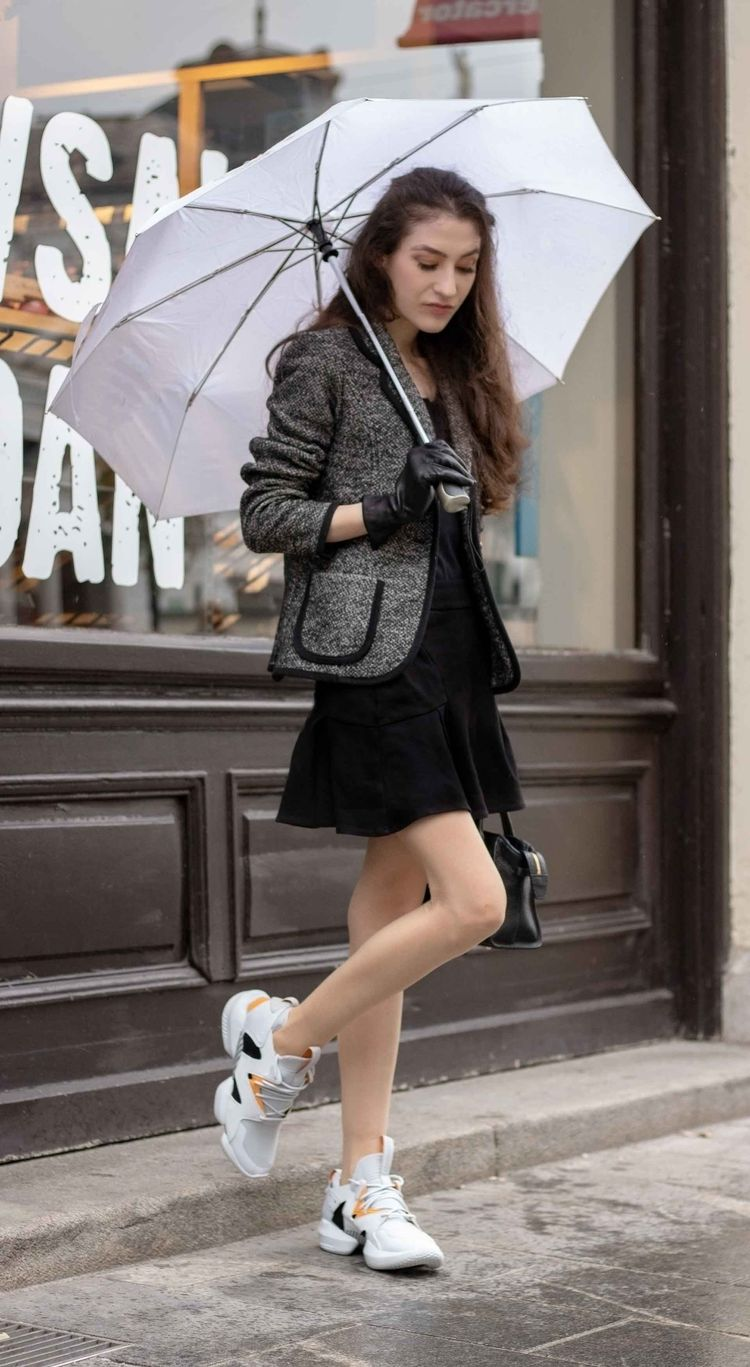 e1f9805810 Fashion Blogger Veronika Lipar of Brunette from Wall Street showing how to  style ugly sneakers with